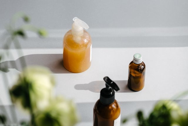 bottles with organic cosmetics in light and shadows