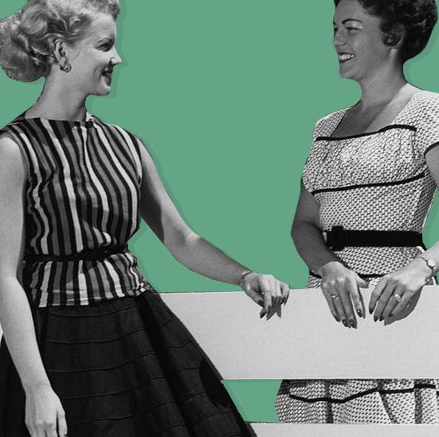two women talking across a fence