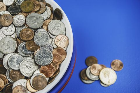 Bowl filled with American cash in patriotic colors. Charity and donation theme