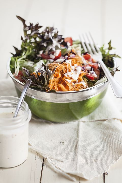 bowl of mixed salad and glass of yoghurt salad dressing