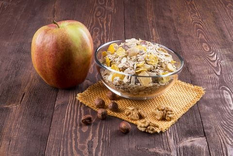 bowl of muesli, apple, nuts, flakes, candied  for a nutritious breakfast with a low glycemic index ensuring plenty of energy for the day.