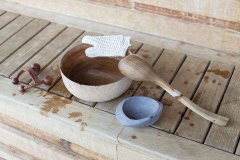 Bowl with ladle and massager in a sauna