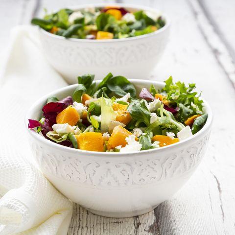 Bowls of autumnal salad with feta and Hokkaido pumpkin