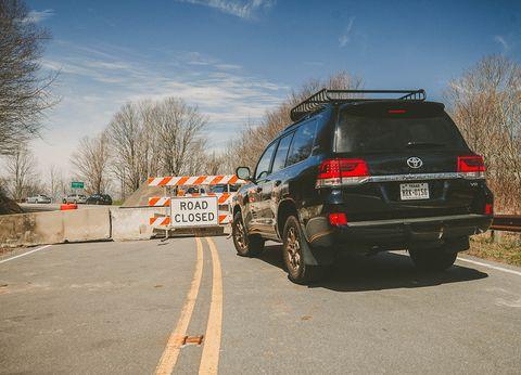 Vehicle, Car, Road, Automotive tire, Luxury vehicle, Automotive exterior, Transport, Infrastructure, Bumper, Mode of transport,