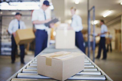 Box on conveyor belt in shipping area