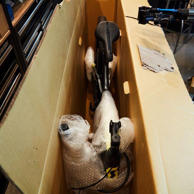 packing a bike in a cardboard box