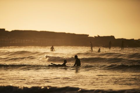 Surfers Enjoy Sunrise at Freshwater Beach