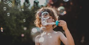 boy  making bubbles outdoor