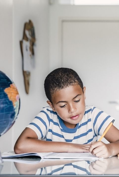 Boy studying at table