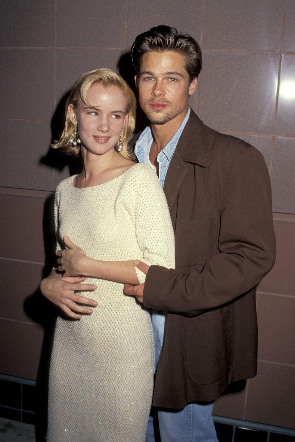 1991: Another Love Pitt gets close to then-girlfriend Juliette Lewis at the Thelma and Louise premiere. The couple began dating when he was 27 and she was 17 and were together for three years until they split in 1993.
