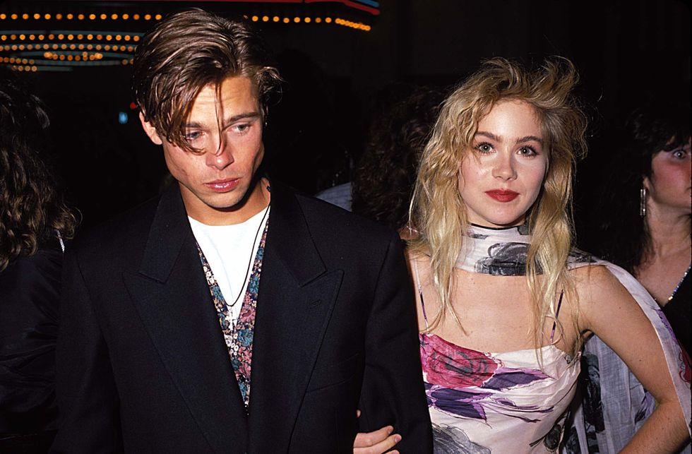 1989: Awards Show Date Wondering why Pitt looks so glum next to the Married … With Children star? Applegate later confessed she went to the MTV Video Music Awards with Pitt, then ditched him for another guy during the show.