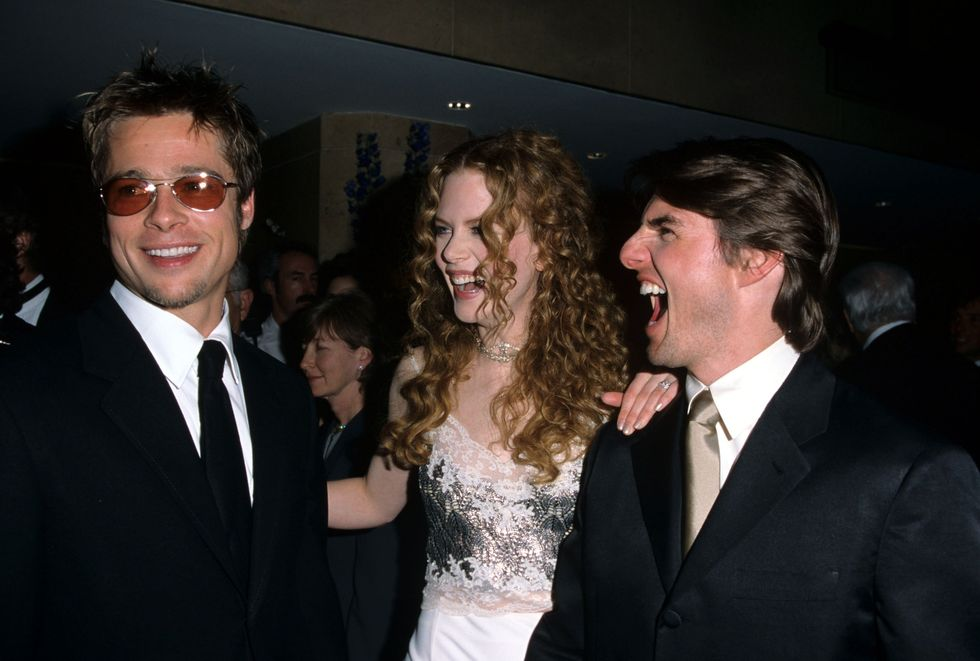 1998: A-List Acquaintances Pitt cracks up Tom Cruise and then-wife Nicole Kidman in April 1998 at an event honoring the Top Gun star. Cruise and Pitt co-starred in Interview with the Vampire in 1994.