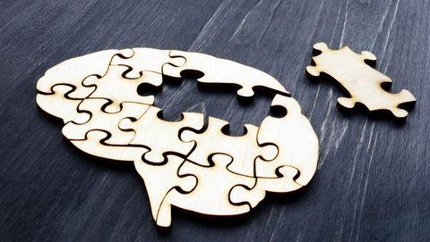 Houten puzzel in de vorm van hersens