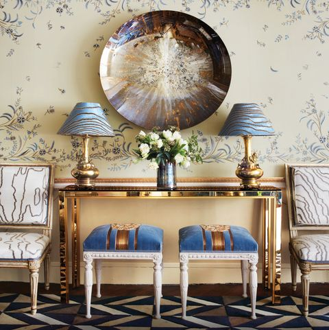Console with geometric carpet and floral wallcovering