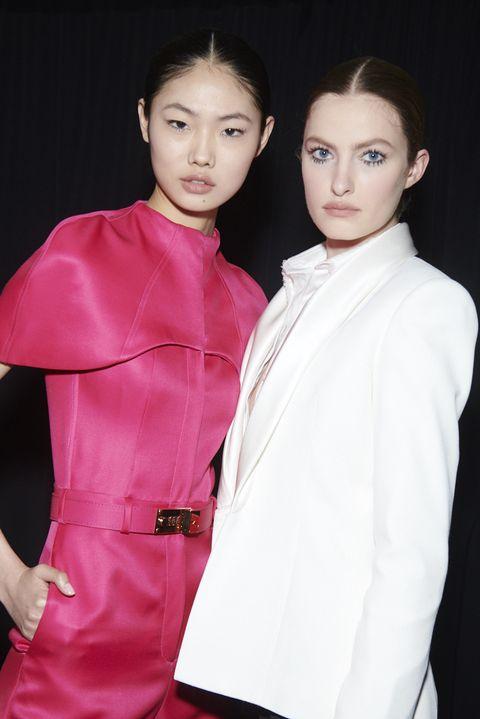 Fashion, Hairstyle, Skin, Beauty, Pink, Fashion design, Outerwear, Coat, Haute couture, Fashion model,