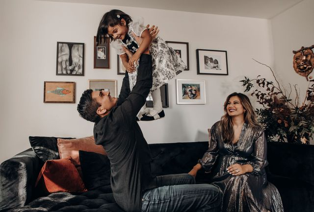 couple with baby on sofa