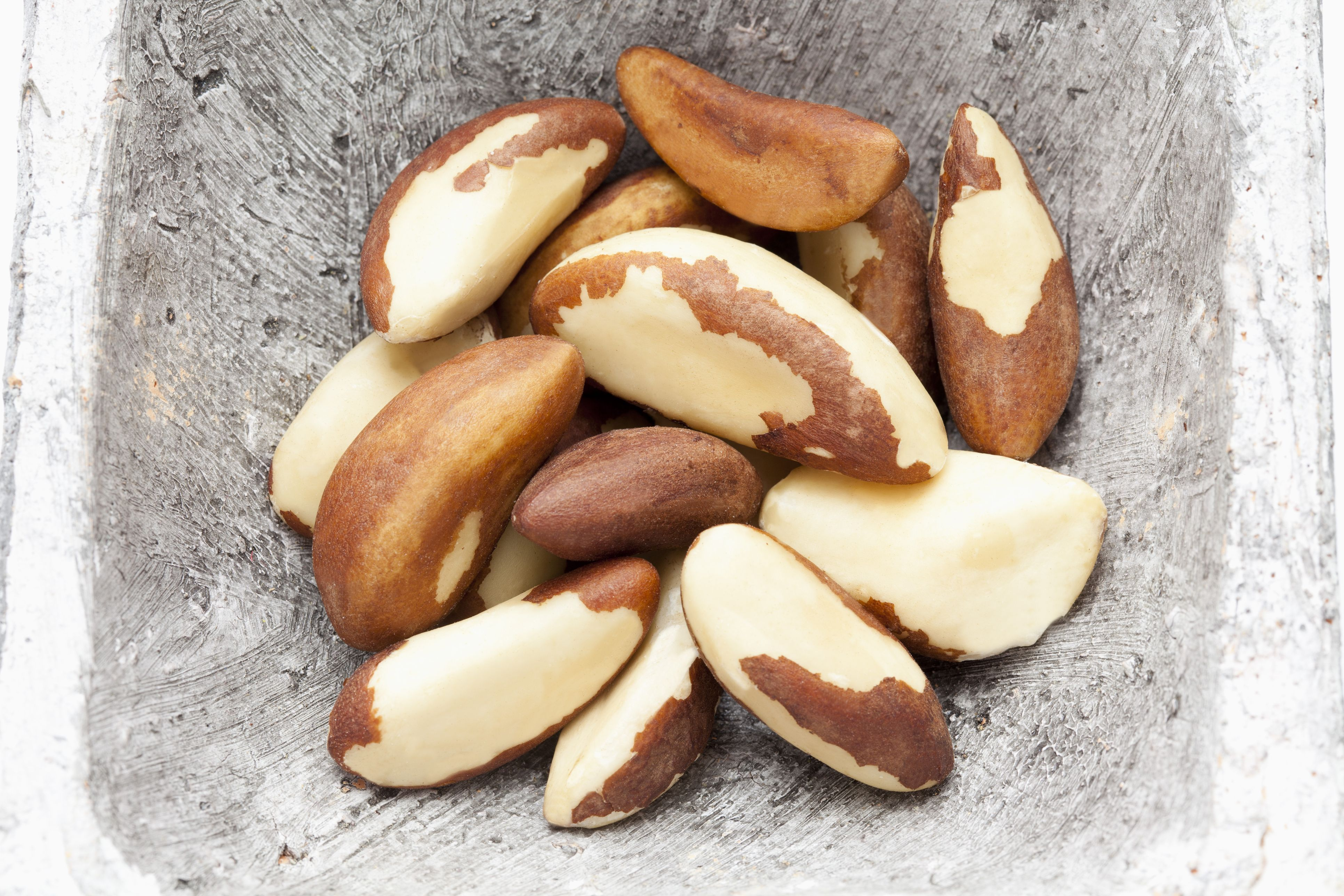 Brazil nuts in container, close up