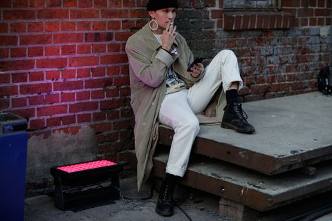 Sitting, Street performance, Footwear, Leg, Musician, Street, Shoe, Performance,