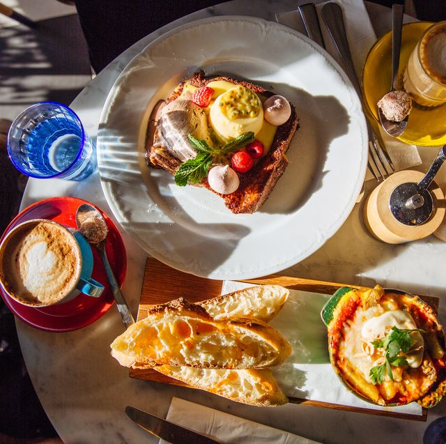 breakfast in cafe with french toast and baked eggs with chorizo, paris, france