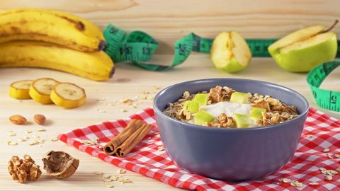 breakfast smoothie bowl with banana, granola and almond