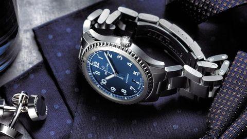 Analog watch, Watch, Watch accessory, Fashion accessory, Strap, Material property, Jewellery, Brand, Metal, Hardware accessory,