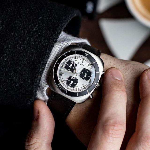 brew chronograph watch on wrist operating pusher