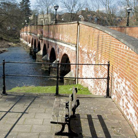 brick bridge over river mole in leatherhead on sunny day