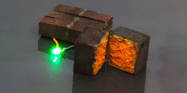 red brick device developed by chemists at washington university in st louis lights up a green light emitting diode