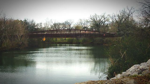 bridge over calm river