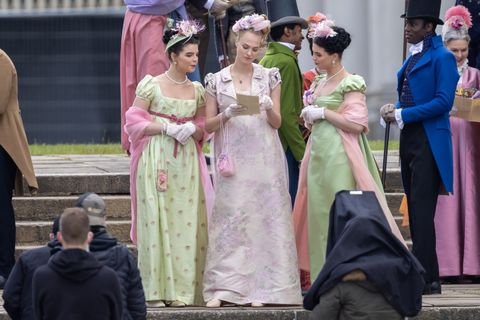 jessica madsen appears to be reading a pamphlet—perhaps something from lady whistledown—on the set of bridgerton season 2
