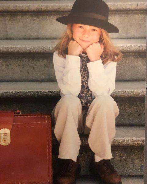 Clothing, Hat, Boot, Leg, Sitting, Cowboy boot, Fashion, Footwear, Riding boot, Fedora,