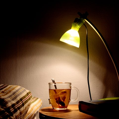 cup of tea on bedside table