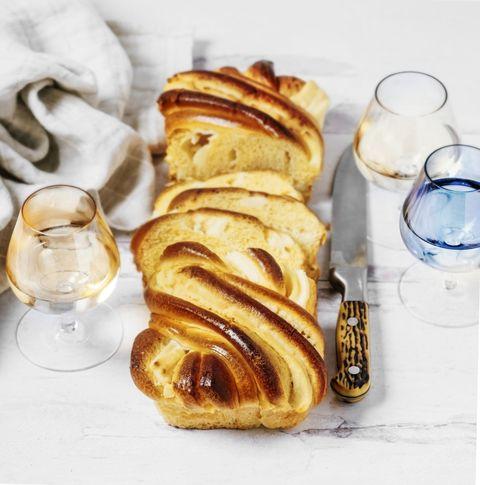 brioche cream cheese swirl  on white, wooden background