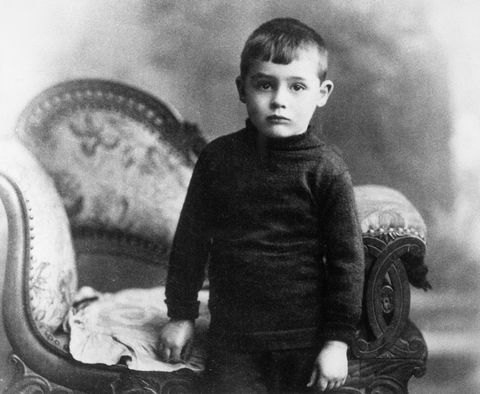 cary grant at age four stands by chair