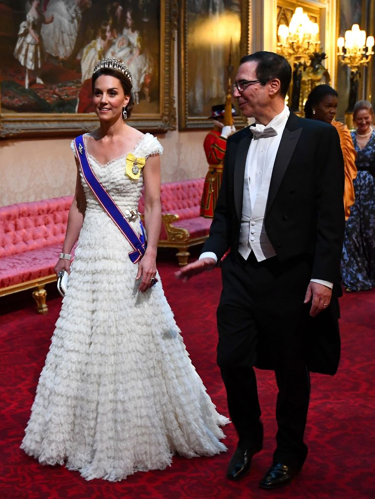 Kate wore a tiered Alexander McQueen gown to a state banquet with Donald Trump . She paired the dress with the Lover's Knot Tiara, and the Queen Mother's sapphire and diamond fringe earrings.
