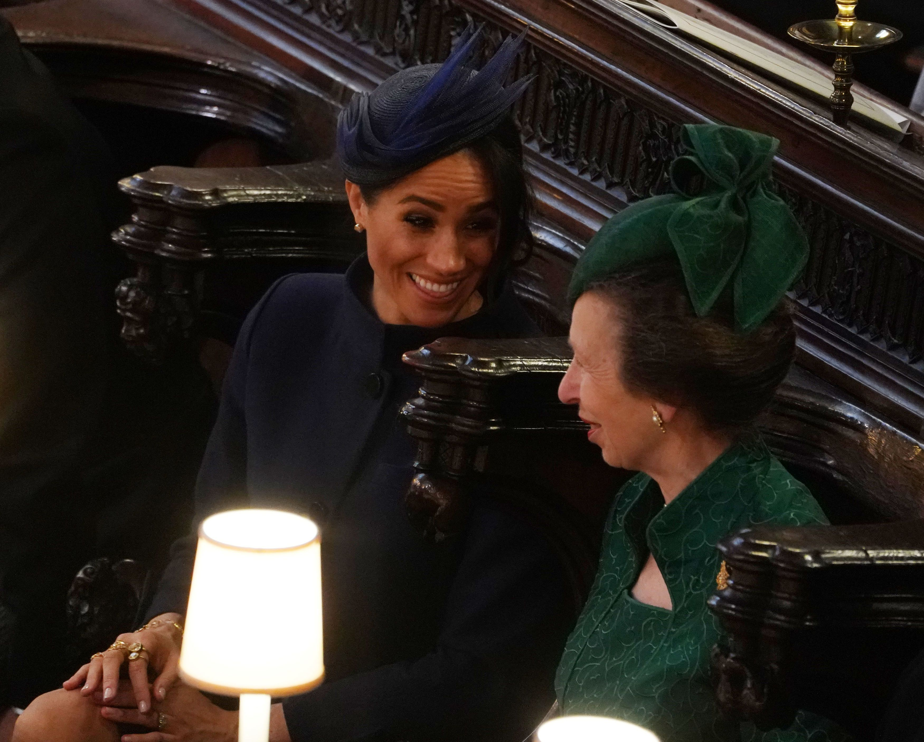 Meghan apparently told the royal family she was pregnant at Princess Eugenie's wedding.