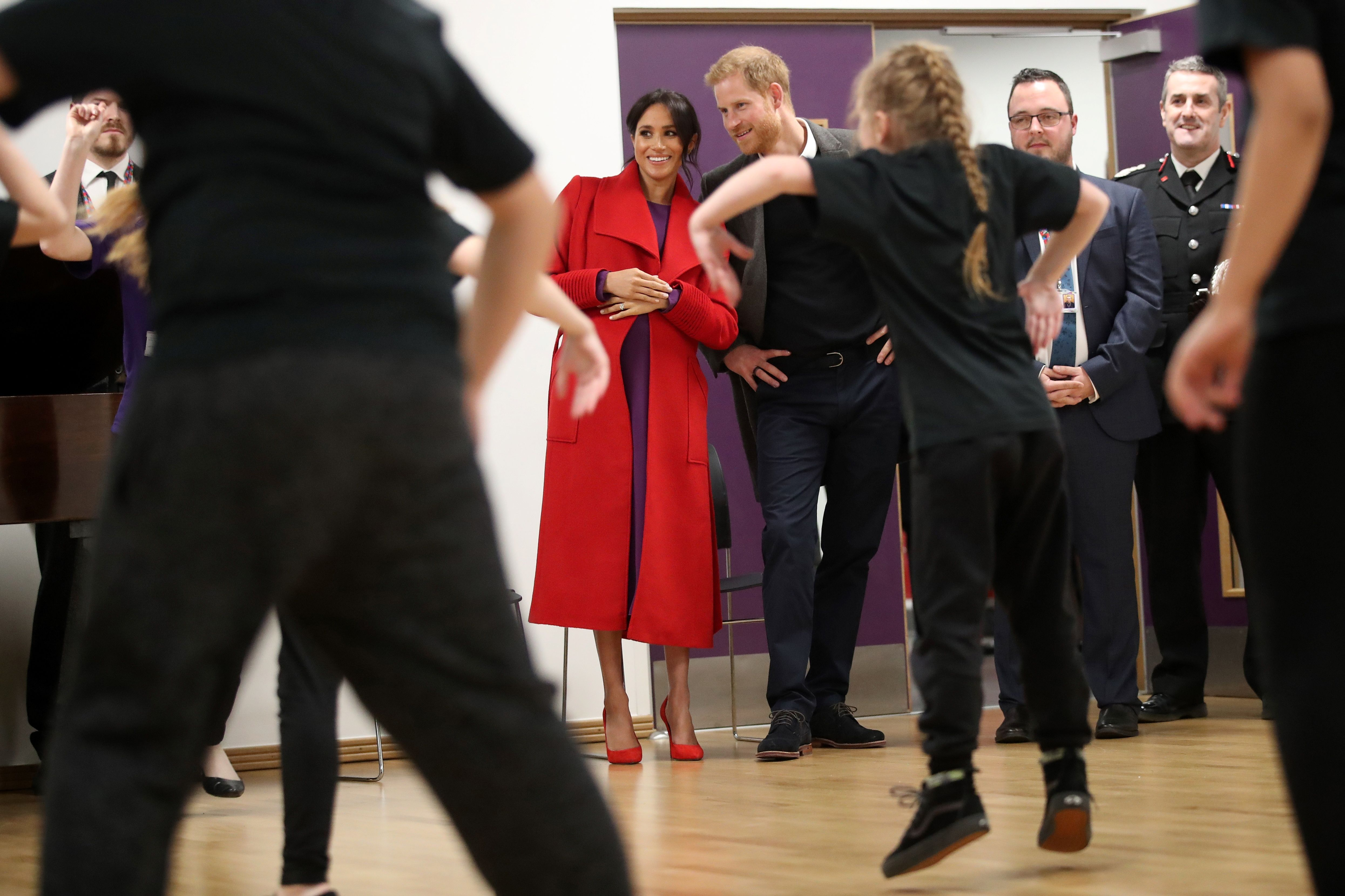 Meghan and Harry look on during a dance performance at The Hive.