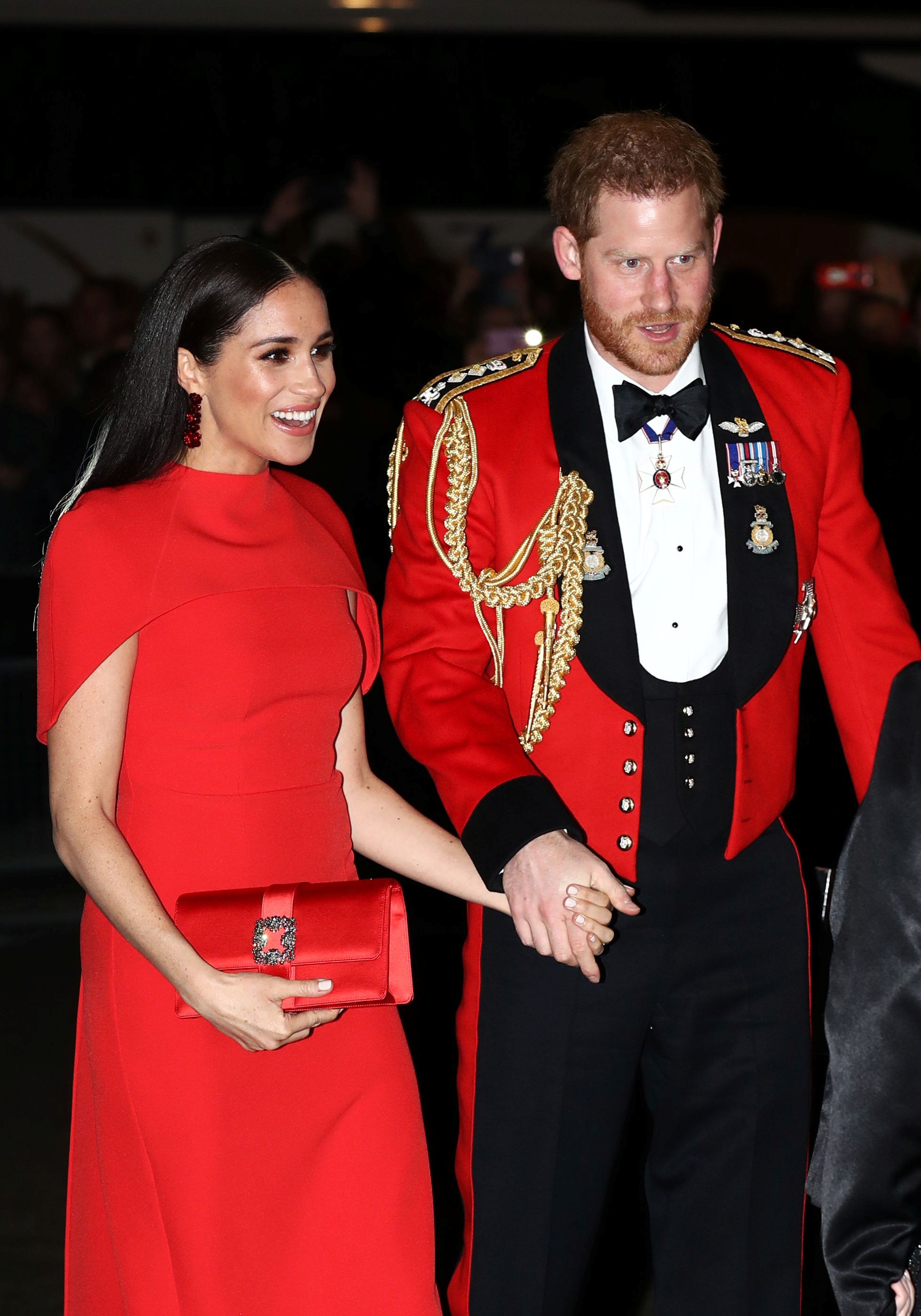 meghan markle comforts prince harry during final royal engagement meghan markle comforts prince harry