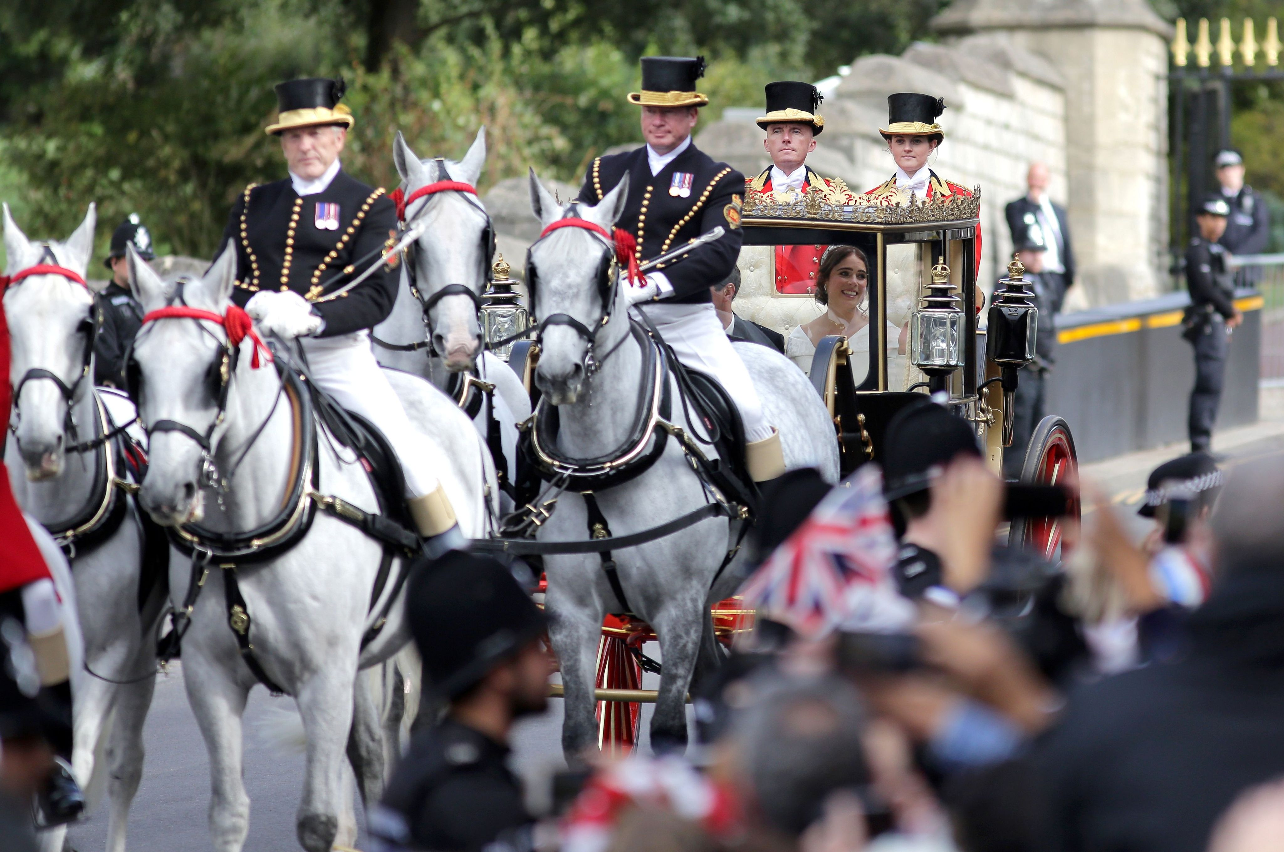 their carriage wound its way through Windsor High Street and the Long Walk, before an afternoon reception hosted by the Queen in St George's Hall at the castle.