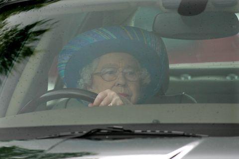 britains-queen-elizabeth-ii-drives-her-j