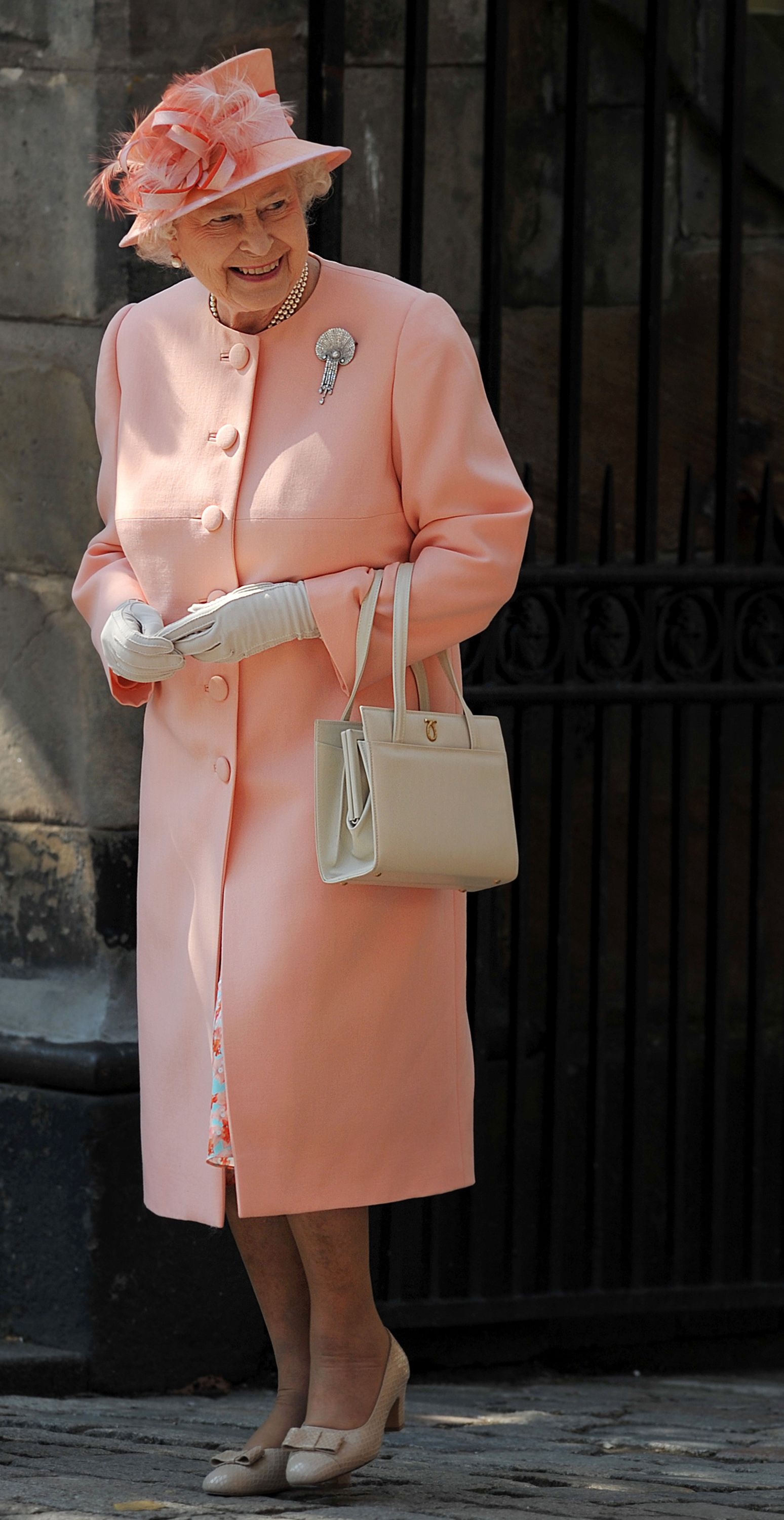 The same year that William and Kate tied the knot, Queen Elizabeth also celebrated the marriage of her granddaughter, Princess Anne's daughter Zara Phillips . To watch Zara marry rugby player Mike Tindall , the Queen looked pretty in peach in a buttoned coatdress, angled peach hat, and the same neutral accessories she sported to William and Kate's nuptials.
