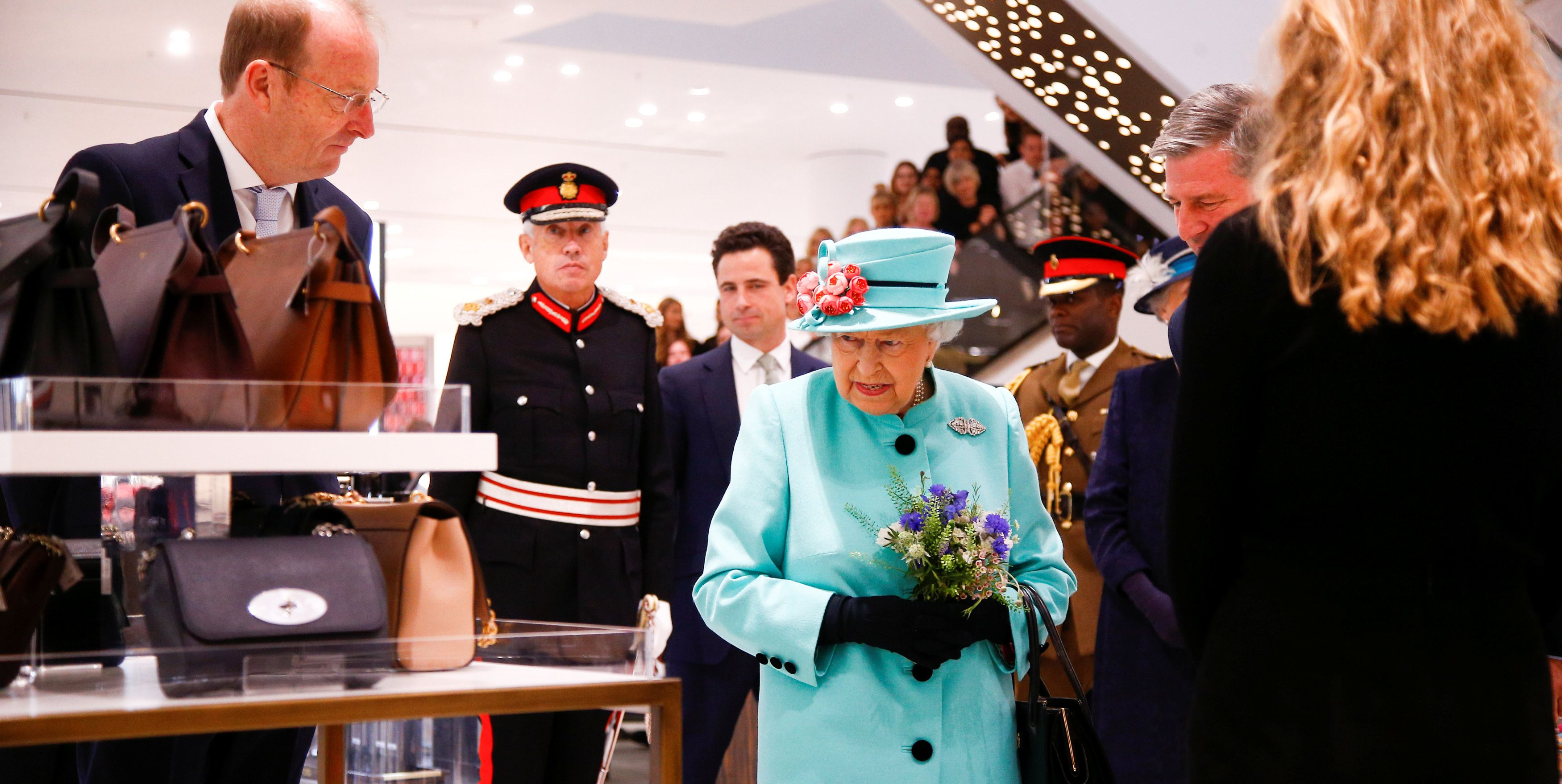 Queen Elizabeth II Browsing Hats and Clutches at the Mall Is a Mood