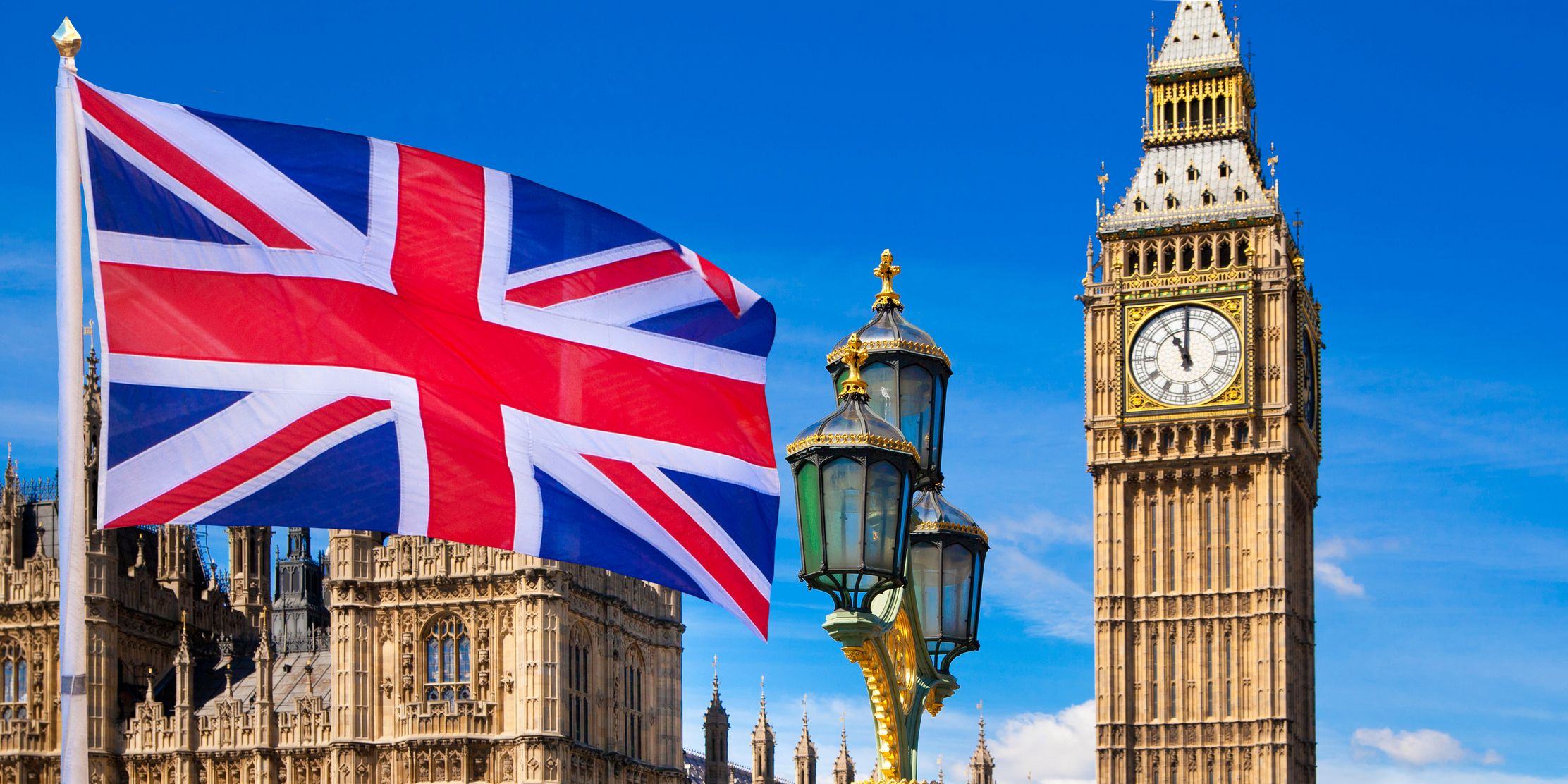 British flag, Big Ben and Houses of Parliament. London