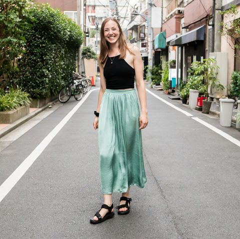 british woman smiling on the streets of tokyo