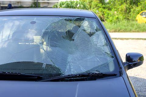Broken car windshield in car accident.