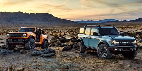 pre production versions of the 2021 bronco, shown here, include bronco two door in cyber orange metallic tri coat and bronco four door in cactus gray