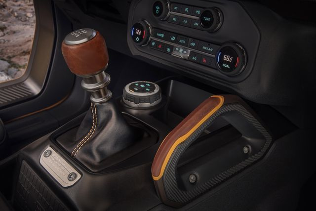 customization details include an available leather wrapped shift lever for the class exclusive 7 speed manual transmission, as well as grab handles in this prototype version of the 2021 bronco not representative of production model static display on private property with aftermarket accessories not available for sale