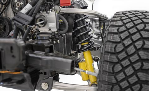 closeup of the 2021 bronco independent front suspension featuring two forged aluminum alloy a arms and available bilstein long travel position sensitive dampers with end stop control valves