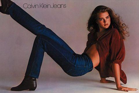 Sitting, Leg, Footwear, Jeans, Thigh, High heels, Knee-high boot, Photo shoot, Knee, Denim,