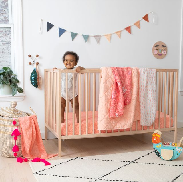 baby in crib with brooklittles bedding